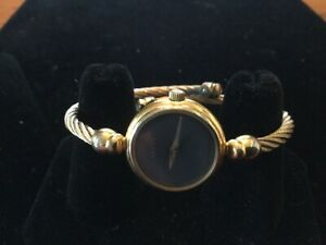 Vintage Gucci 27002L bangle style ladies watch. With original papers