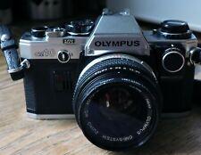 Olympus OM10 35mm SLR Film Camera with 50mm Lens &Manual Adapter Incl.