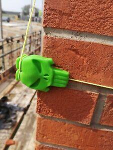 BRICK LINE BLOCKS . 2 green plastic customised skull corner line blocks