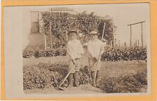Real Photo Postcard RPPC - Twin Brothers - Young Gardeners #2 with Hoe and Rake