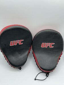 1 PAIR OF ULTIMATE FIGHTING CHAMPION (UFC) PUNCHING MITTS/ STRIKE PADS