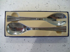 """couverts à salade """" Guy Degrenne """", Inox finition miroir."""