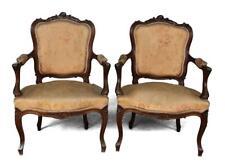 Paire de fauteuil de style Louis XV en noyer tapissé soie