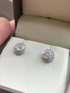 Diamond stud earrings, 18ct white gold diamond clusters,centre stone.