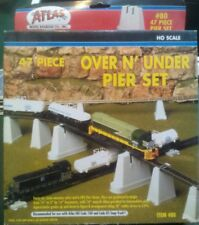 Ho scale 47 piece over N under pier set by Atlas