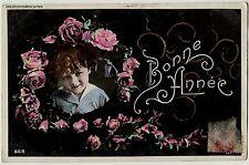 Carte Postale Ancienne - Bonne année - Petit garçon dans un médaillon de fleurs
