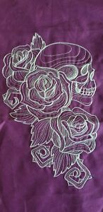 Purple background with white skull & roses embroidered applique motif