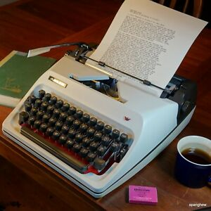 1976 Adler J5 portable typewriter w/case and new ribbon: In superb condition.