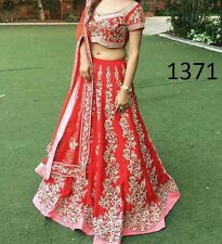 Designer Wear Tapeta Silk with Net Bridal Lehenga