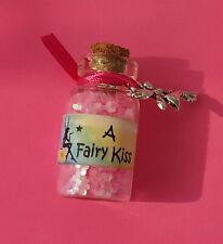bottle of fairy kiss dust (pink) with an organza bag