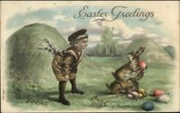 Easter - Boy Watching Rabbits w/ Eggs c1910 Embossed Postcard