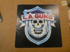 L.A.Guns Record Store Flat Autographed By Tracii Guns 12 X 12