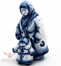 Gzhel porcelain figurine folk Russian woman with a child on a winter walk