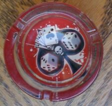 A NEW POKER GLASS  ASHTRAY WITH CARDS AND DICE AND SKULL HEAD