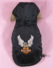 Small dog winter coat has eagle design crest with faux fur trimmed hoodie, lined
