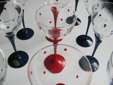 Blue/red plastic wine glasses. Two different styles.