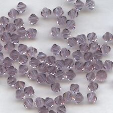 T6 5301 LA *** 15 toupies Swarovski 6mm LIGHT AMETHYST