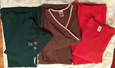 Three sets of nursing scrubs:  top and pants green, brown red. XS and small