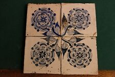 Antique delft blue and white tiles with flowers in a square