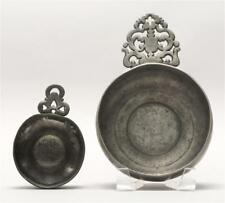 "Two Pewter Porringers Both with openwork handles. Lengths 4.75"" and 7. Lot 577"