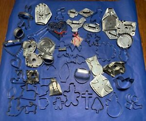 LARGE LOT (60) METAL CUTTERS: includes handmade, old aluminum, signed, unique