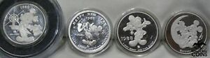 LOT OF 4: 1988 & 1990 DISNEY 1oz SILVER .999 MICKEY MOUSE COINS NEW YEARS, GOOFY
