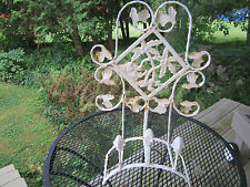 Shabby white decorative wall hanging, iron with rust. Architectural piece.