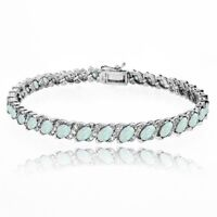 Simulated White Opal Tennis Bracelet with White Topaz Accents in Sterling Silver