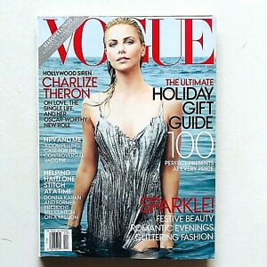 US Vogue magazine USA december 2001 dicembre Charlize Theron Glittering Fashion