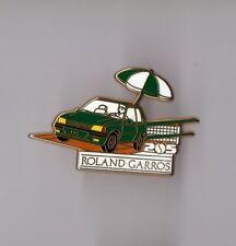 Pin's Roland Garros / peugeot 205 (version parasol signé Arthus Bertrand)
