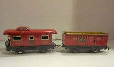 Two New York Central red tin railroad cars # 554 & 556 marked made in U.S.A.