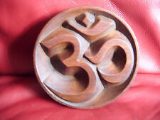 Handmade wooden Om wall plaque in a polished wood finish