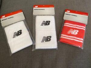 NWT New Balance wrist sweat bands - 3 white and 1 orange