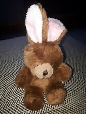 Small brown bunny soft toy with pink ears