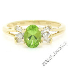 14K Yellow Gold 1.25ctw Oval Peridot Solitaire Ring w/ Baguette & Round Diamonds