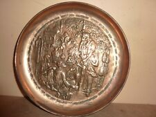 INDO- PERSIAN 21.8CM COPPER DISH/CHARGER WITH EMBOSSED LADY, 2 MEN WITH BUILDING