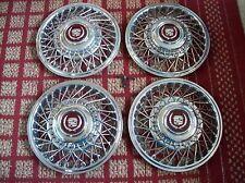 "1986-1988 Cadillac & 1988 Eldorado/ Seville Set of four 14"" wire hubcaps & locks"