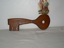VINTAGE WOODEN KEY SHAPED KEY HOLDER, HAS FOUR METAL HOOKS