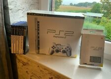 Sony PlayStation 2 Slim Silver OVP / 8MB MemCard / 6 Spiele / Silverstand