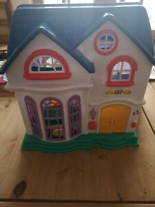 Fisher price loving family dolls house
