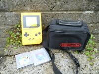 Original Nintendo Gameboy yellow hand held console with bag and 2 games working