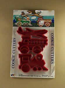 1987 LK Mfg Corp Cookie Cutter Set 3 NIP Painting + Recipe Plane Truck Train