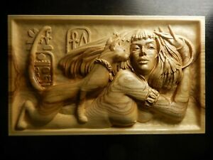 Wood carved picture wall decoration plaque. Nude Egyptian woman and the cat