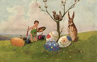 boy painting Easter eggs Bunny and birds watching beautiful artist postcard