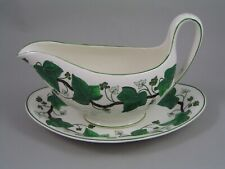 WEDGWOOD GREEN NAPOLEON IVY GRAVY BOAT AND SAUCER, A/F.