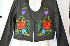 CHAQUETA ESTAMPADA PRIMAVERA  Bullfighter jacket printed in embroidered flowers.