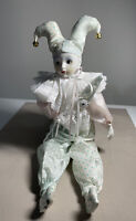 """Porcelain 16.5"""" Harlequin Jester baby Doll holding a toy Taiwan. Pink, blue"""