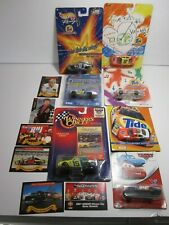 Seven 1/64 scale Nascars in sealed plastic plus seven trading cards excellent