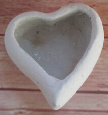 A Small Plant Pot Heart-Shaped Made of Concrete