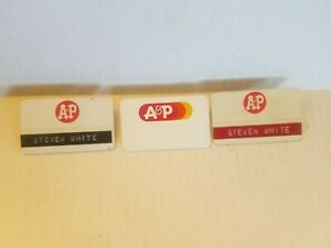 UP FOR BID IS THREE A & P NAME TAGS.